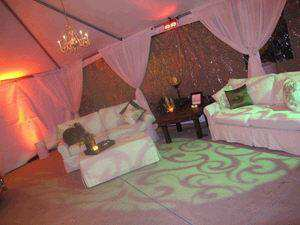 Tenting Inspiration with Swagged Fabric Around Poles from Ventura Rental Party Center
