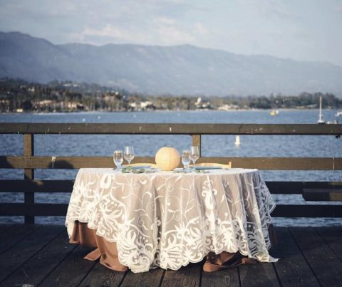 Decorated outdoor table for wedding by the ocean catered by Catering Connection.