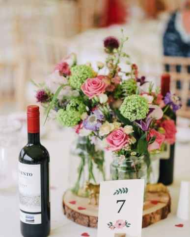 bottle of wine and flowers provided by the caterer